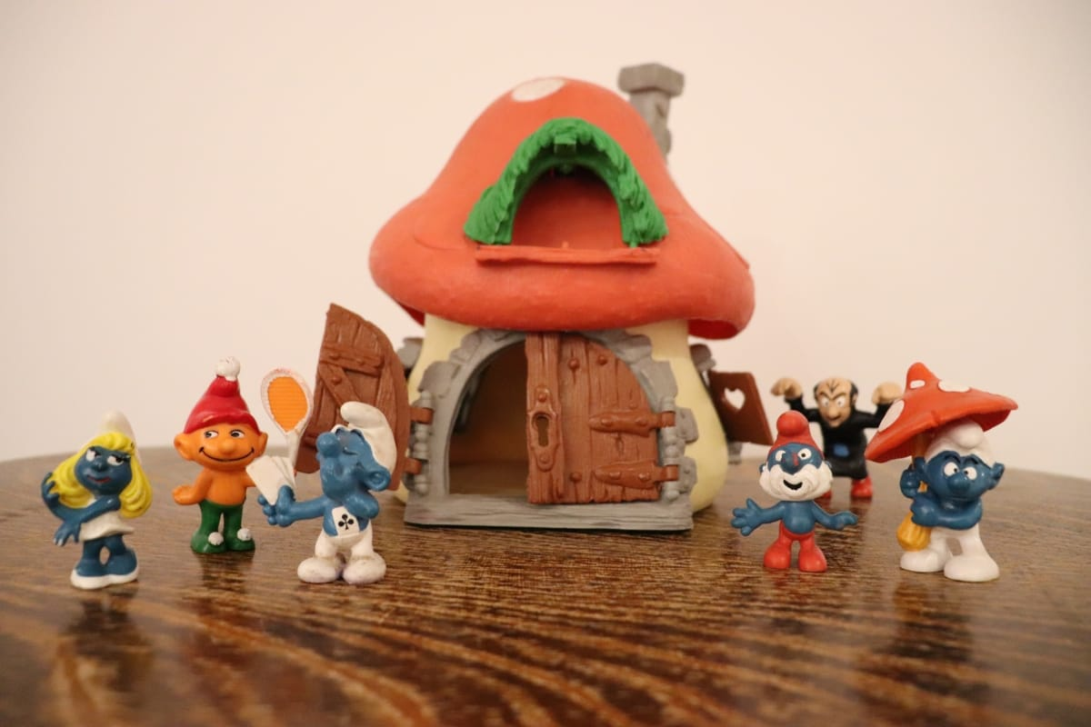 Smurfs in front of a Smurf house